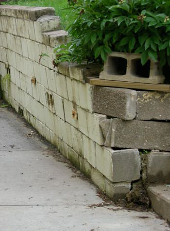 collapsing retaining wall with severe damage in Kawartha Lakes