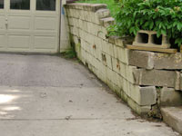 a failing retaining wall around a driveway in Toronto