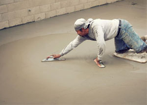 smoothing out the grout in a slab releveling project in Richmond Hill