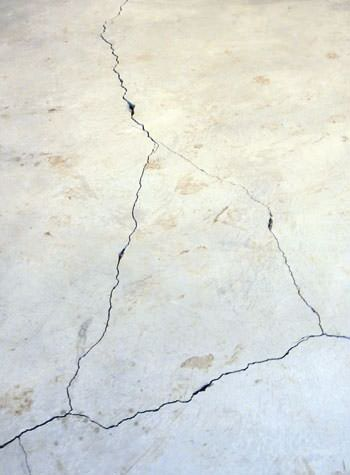severely cracked, heaving slab floors in a home in Georgina