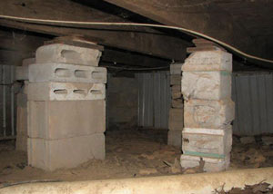 crawl space repairs done with concrete cinder blocks and wood shims in a Pickering home