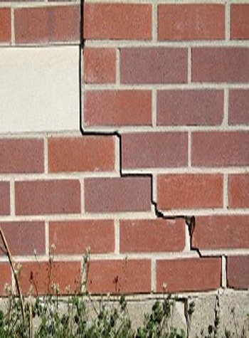 photo of a rotating foundation wall with cracks in Orillia