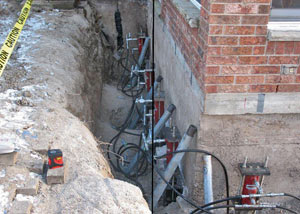 Foundation push piers installed around a house with a foundation settlement issues in Orillia