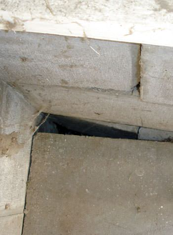 inward rotation of a foundation wall damaged by street creep in a garage in Aurora