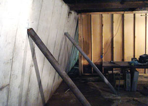 A severely tilting foundation wall propped up by steel beams in Orangeville.