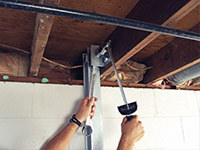 Straightening a foundation wall with the PowerBrace™ i-beam system in a Oshawa home.