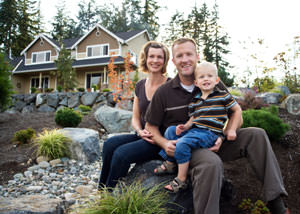 A happy family outside a home with a repaired foundation in Georgina