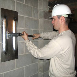installing a wall anchor to repair an bowing foundation wall in Oshawa