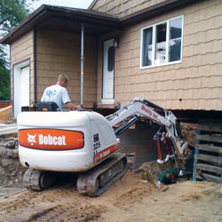 Excavating to expose the foundation walls and footings for a replacement job in Barrie