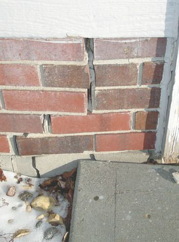 Severe street creep damage to a garage wall outside a New Tecumseth home